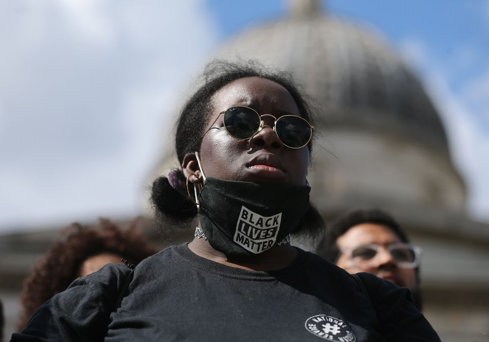 A demonstrator wearing a face mask at a Black Lives Matter protest in Trafalgar Square, London, on June
