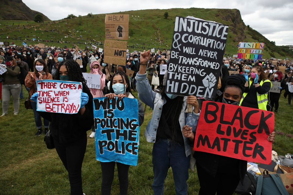 People take part in a Black Lives Matter protest rally in Holyrood Park, Edinburgh, on June