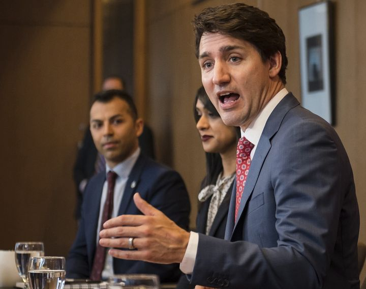 Prime Minister Justin Trudeau, alongside MPs (from left) Marwan Tabbara and Bardish Chagger meet with Region of Waterloo mayors in Kitchener, Ont. on April 17, 2019.