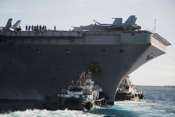 The USS Theodore Roosevelt departs Apra Harbor at Naval Base Guam on Thursday, May 21, 2020, following an extended visit to G
