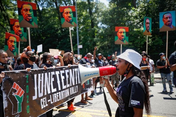 Protesters chant and march after a Juneteenth rally at the Brooklyn Museum in that New York City borough on June 19.