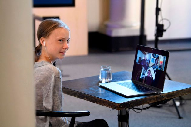 Swedish climate and environmental activist Greta Thunberg is seen in video conversation with Swedish...