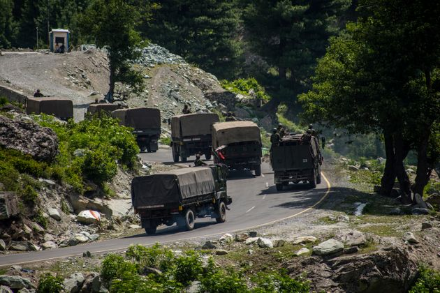 Indian army convoy drives towards Leh, on a highway bordering China, on June 19, 2020 in Gagangir,