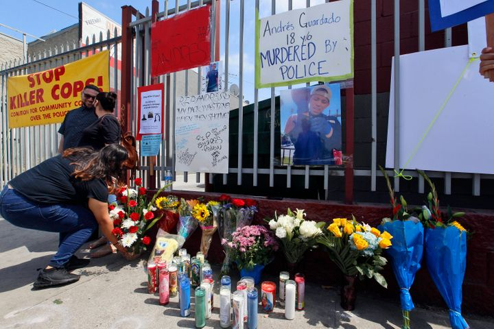 Friends leave candles and flowers at a makeshift memorial for Andres Guardado on Friday in Gardena, California, near where he