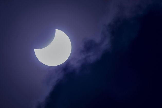 The moon partially covers the sun during an annular solar eclipse as seen from Bangalore on June 21,
