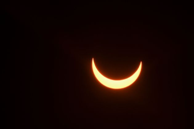 The moon partially covers the sun during an annular solar eclipse as seen from New Delhi on June 21,