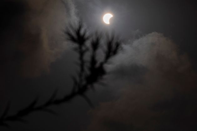 A partial solar eclipse is seen in Hefer Valley, Israel, Sunday, June 21, 2020. (AP Photo/Ariel