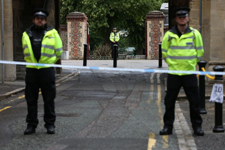 Police at the Abbey gateway of Forbury Gardens in Reading town center following a multiple stabbing attack on Saturday.