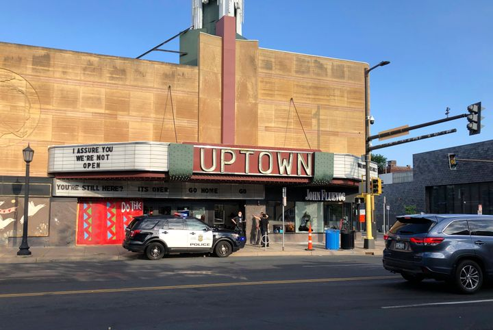 A police vehicle is parked outside the Uptown Theatre Sunday, June 21, 2020, following a shooting in Minneapolis' Uptown neig