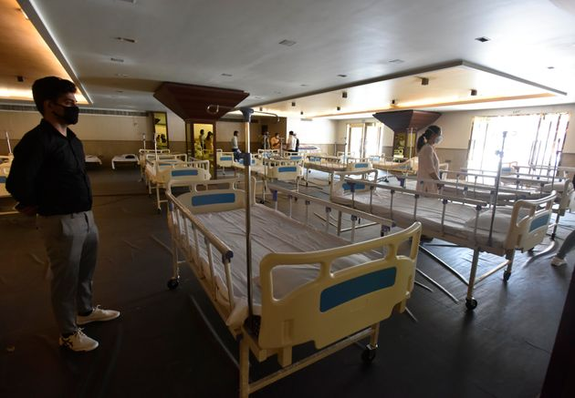 New beds set up inside the Shehnai Banquet Hall-temporarily converted to a quarantine facility for COVID-19...