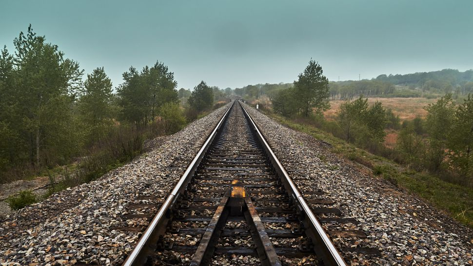 In a new era of social distancing and an ongoing battle over climate change, railroads suddenly look like the smarter choice.