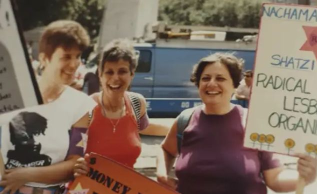 The author (right) at a Pride parade with Radical Jewish Lesbians Organizing in the early 1970s.