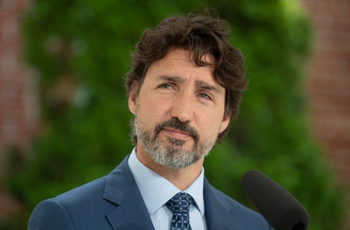 Prime Minister Justin Trudeau listens to a question during a news conference outside Rideau Cottage in Ottawa on June 22, 2020.