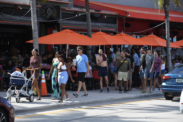 Crowded sidewalks Saturday in Fort Lauderdale Beach, Florida, show a lack of health precautions, such as social distancing an
