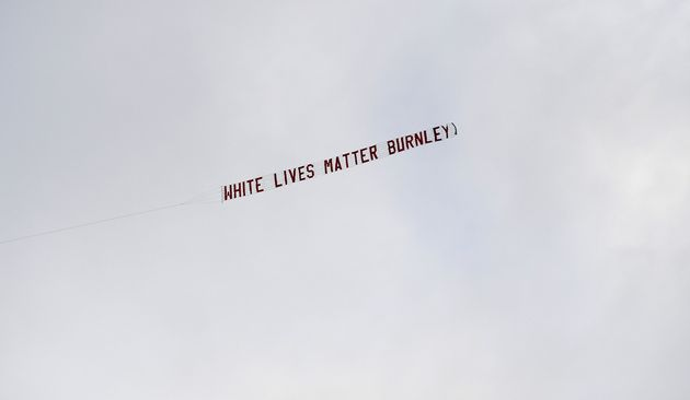A plane flies over the stadium with a banner reading 'White Lives Matter Burnley' during the Premier...