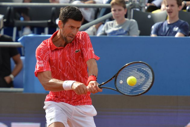 Serbia's Novak Djokovic returns the ball during an exhibition tournament in Zadar, Croatia, Sunday, June...