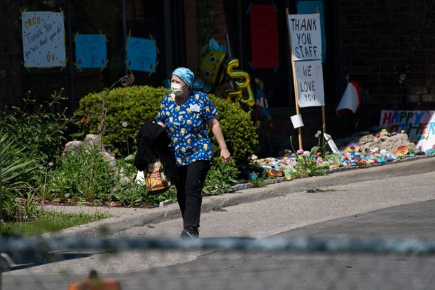 A home-care worker is shown outside Orchard Villa long-term care home in Pickering, Ont., on May 26,
