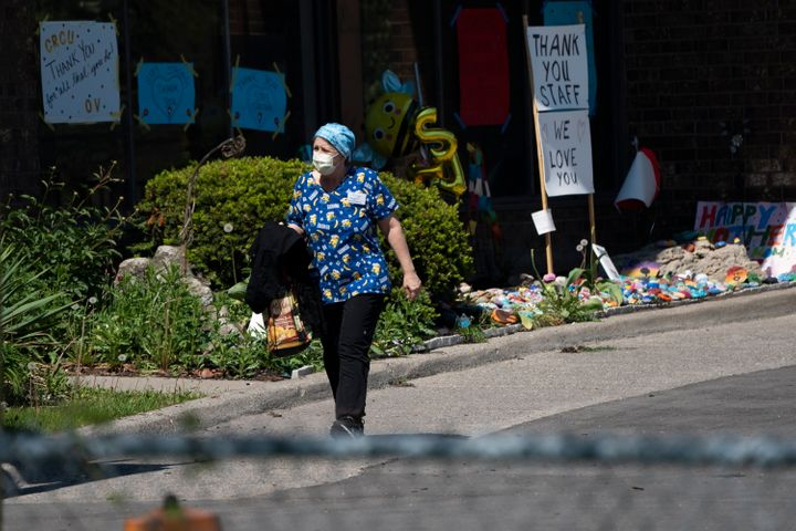 A home-care worker is shown outside Orchard Villa long-term care home in Pickering, Ont., on May 26, 2020.
