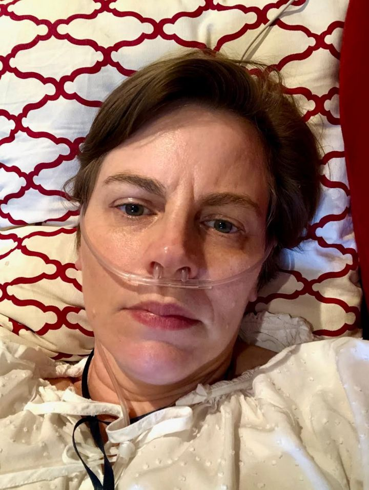 The author on her couch receiving oxygen in June 2020.