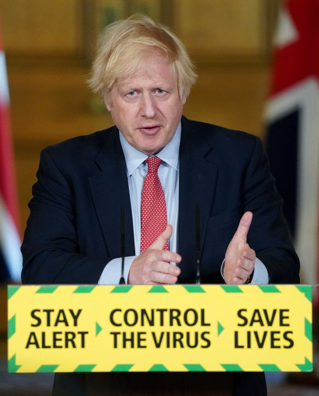 Prime minister Boris Johnson gestures during a coronavirus media briefing in Downing
