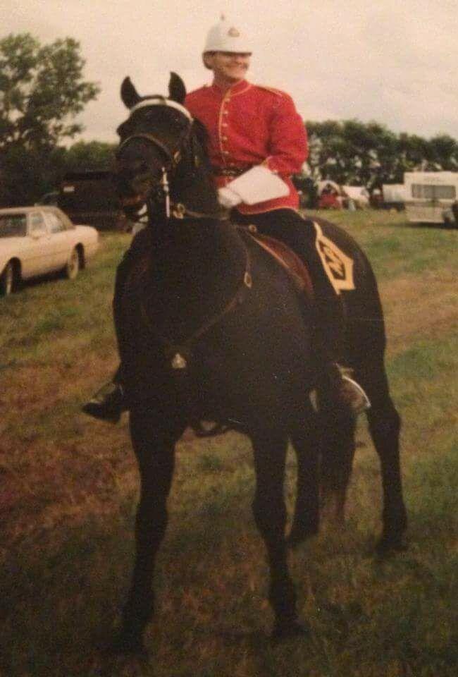 The writer wearing a period RCMP uniform on horseback.