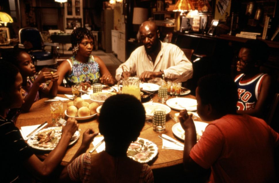 """Alfre Woodard, Delroy Lindo and their fictional children in """"Crooklyn."""""""