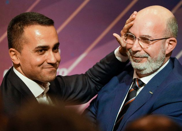 Italy's Foreign Minister and 5-Star Movement leader Luigi Di Maio, left, embraces his successor Vito...