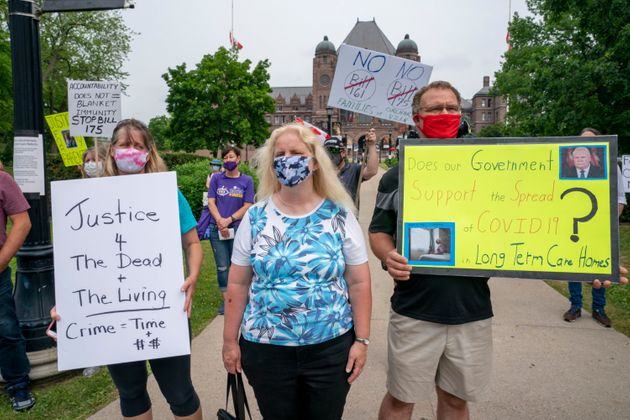 Demonstrators protest against Bill 175 and Bill 161 outside the Ontario legislature in Toronto on June...