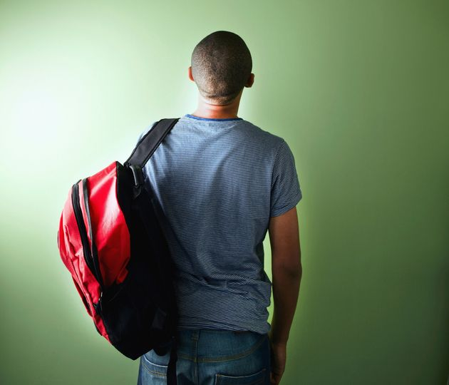 Schoolboy with backpack, rear