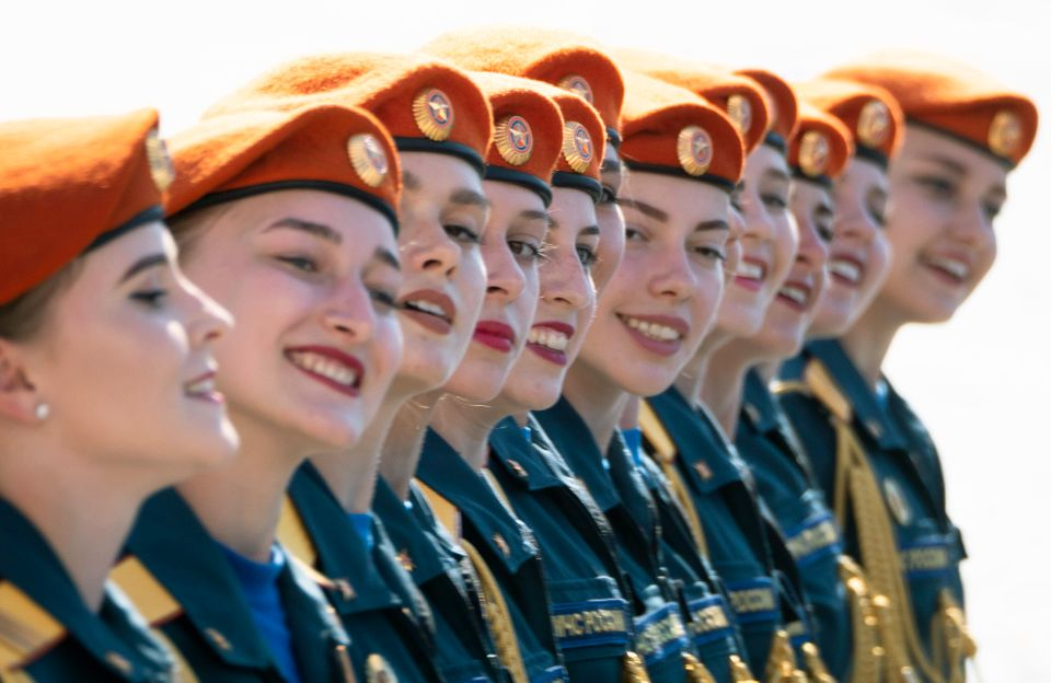 Female Ministry of Emergency Situations employees march during the Victory Day military parade marking...
