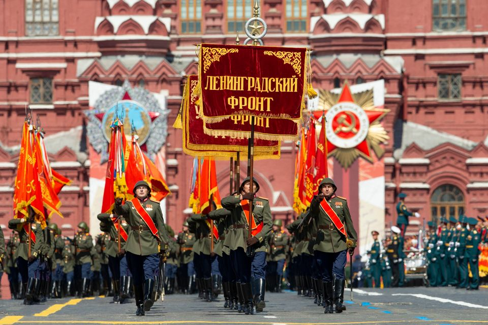 Russian soldiers wearing WWII-era uniforms march in Red Square during the Victory Day military parade...
