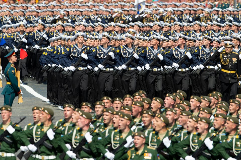 Russian sailors, center, march in Red Square during the Victory Day military parade marking the 75th...