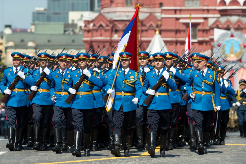 Serbian Army soldiers march in Red Square during the Victory Day military parade marking the 75th anniversary...