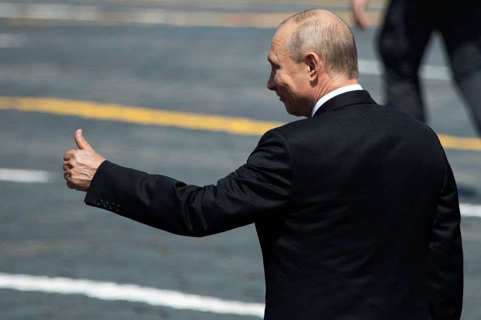 Russian President Vladimir Putin gestures as he leaves Red Square after the Victory Day military parade...