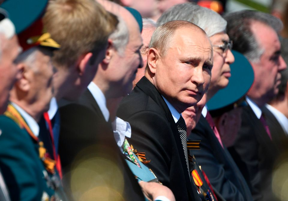 Russian President Vladimir Putin looks on during the Victory Day military parade marking the 75th anniversary...