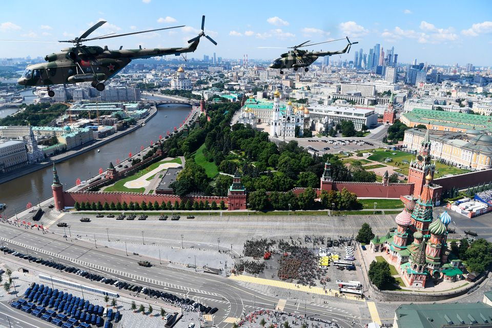 Russian army Mi-8 military helicopters fly over Red Square during the Victory Day military parade marking...