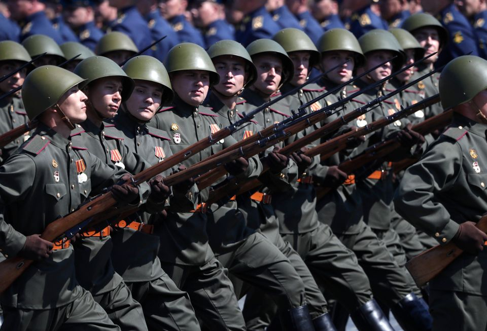 Russian soldiers dressed in Red Army World War II uniforms march toward Red Square during the Victory...