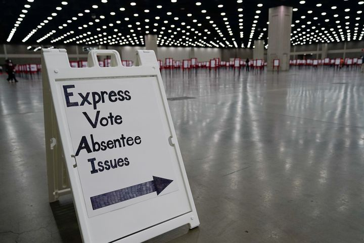 A sign directs voters on primary election day in Louisville, Kentucky, Tuesday.