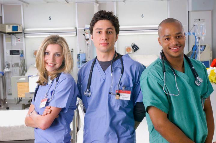 "Sarah Chalke, Zach Braff and Donald Faison in the first season of ""Scrubs."""