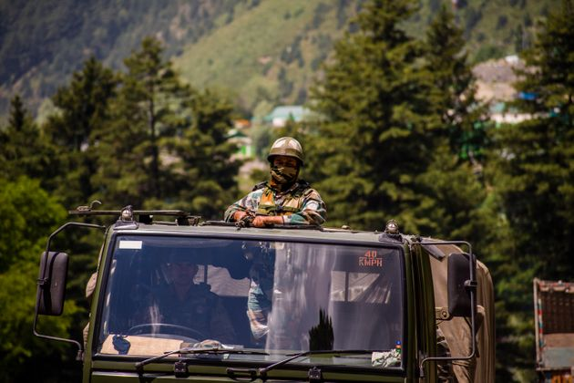 An Indian army convoy drives towards Leh on June 19,