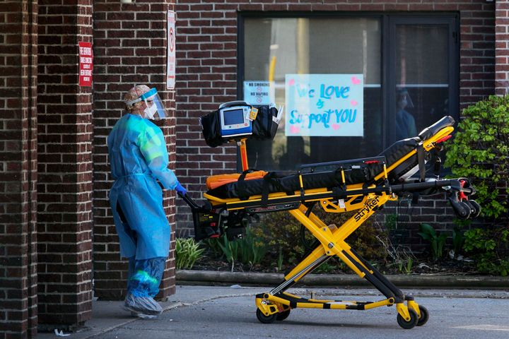 A paramedic rolls a stretcher into the Hawthorne Place Long Term Care Centre in Toronto on May 20, 2020. The long-term care facility is one of many in Ontario that has reported several COVID-19 infections.