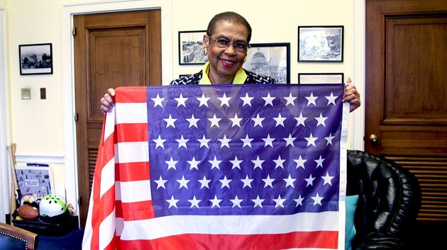 Del. Eleanor Holmes Norton holds an American flag with 51 stars in her Washington office on Feb.