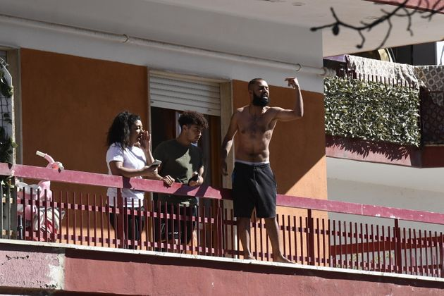 Residents living in a building inside the red zone where new 49 cases of coronavirus infections were...