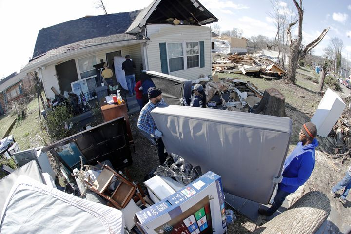 A group of volunteers moves items salvaged from a damaged home on March 6 in Nashville, Tennessee.