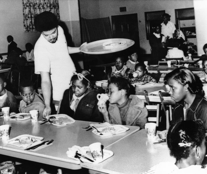 A member of the Black Panther chapter in Kansas City serves free breakfast to children in April 1969 before they go to school