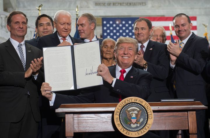 President Donald Trump signs a proclamation shrinking Bears Ears and Grand Staircase-Escalante national monuments at the Utah State Capitol in Salt Lake City, Utah, in December 2017.