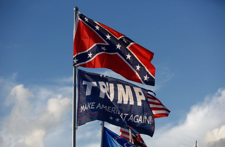 "A Trump ""Make America Great Again"" flag flies below a Confederate flag at a private campground by the Bristol Motor Speedway"