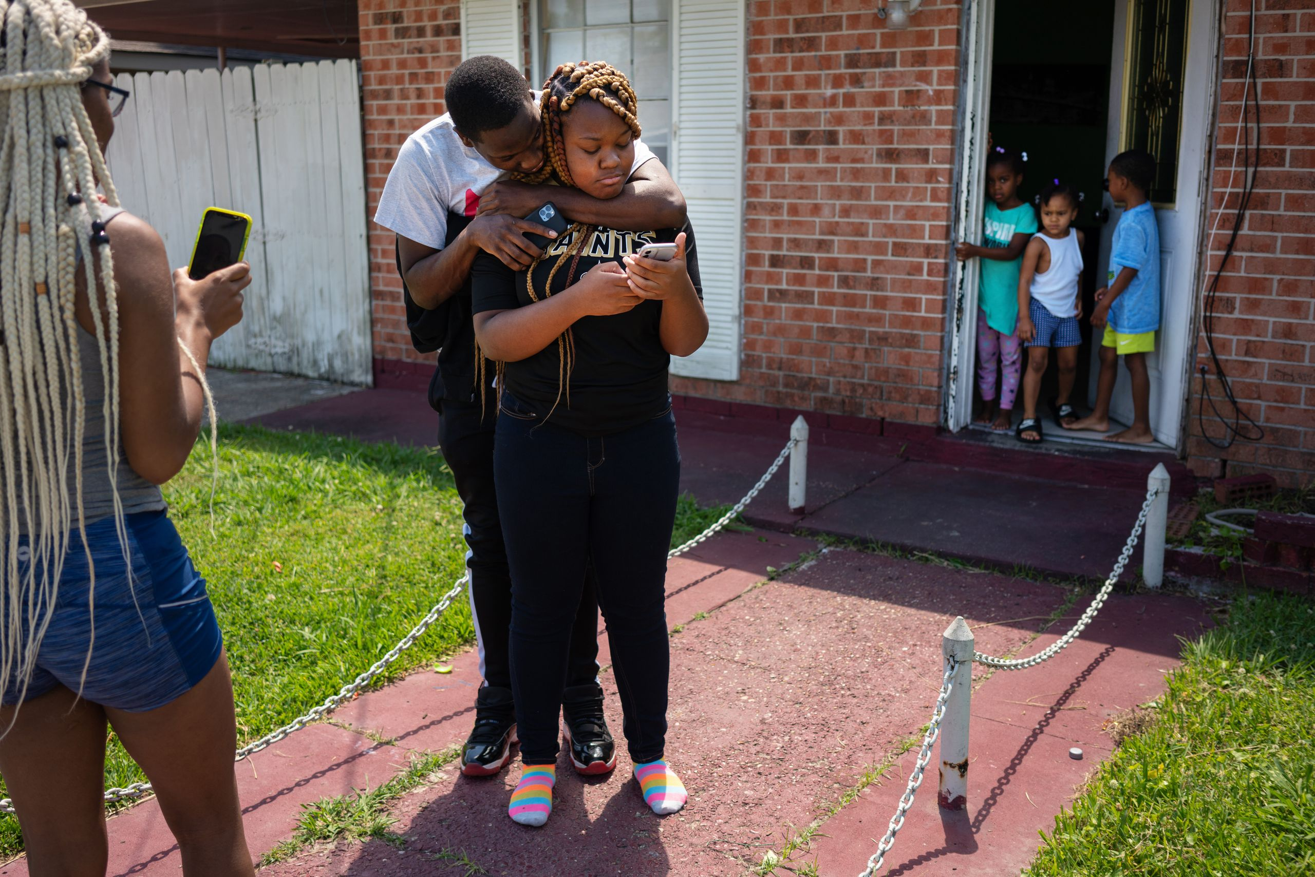 Troynique Turner, left, and Troy Green Jr. try to console their sister, Trevianne, who had just found out over a Zoom call th