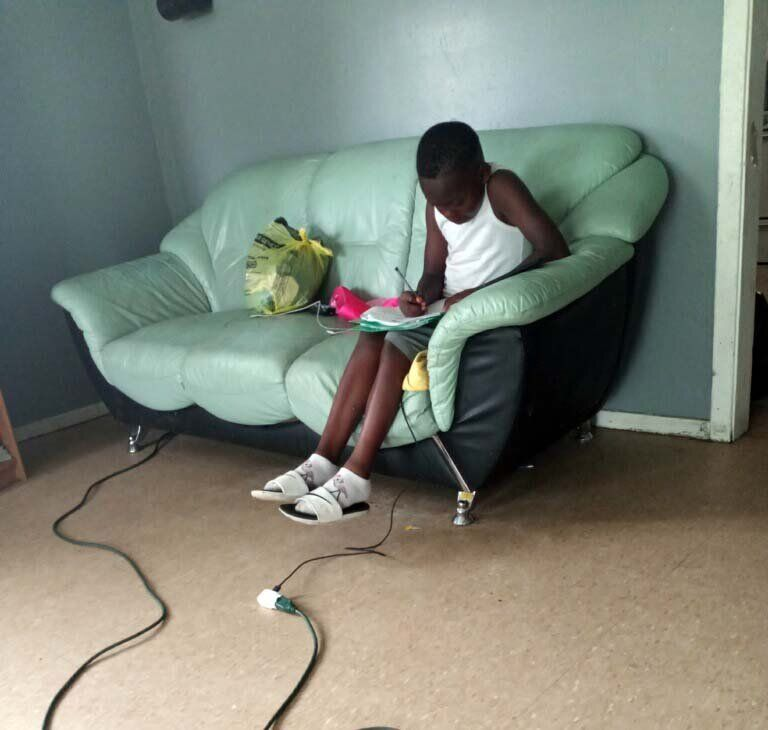 Amareon works to finish his instructional packet a few hours before the district's deadline. He had attempted to keep u