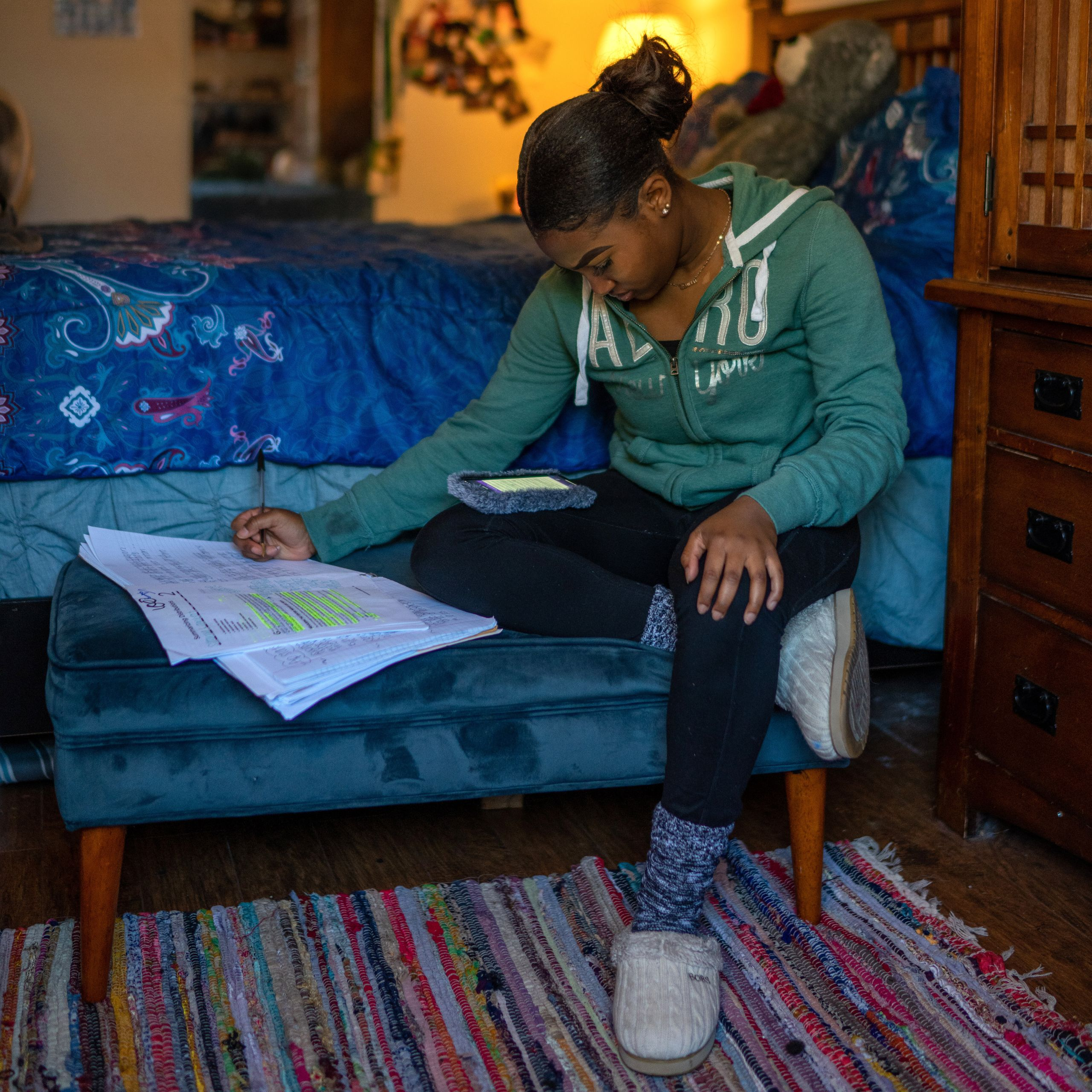 Satoriya Lambert does homework in her room after the coronavirus shuttered schools for the rest of the year in New Orleans. S